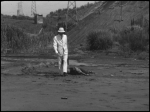 Man in the white suit: the mysterious stalking killer who murders our miner protagonist in a case of mistaken identity