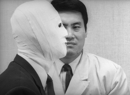 To visually evoke Okuyama's identity-split, Teshigahara frequently frames him in a mirror, or fits his face into composition with the face of Dr K, his alter-ego